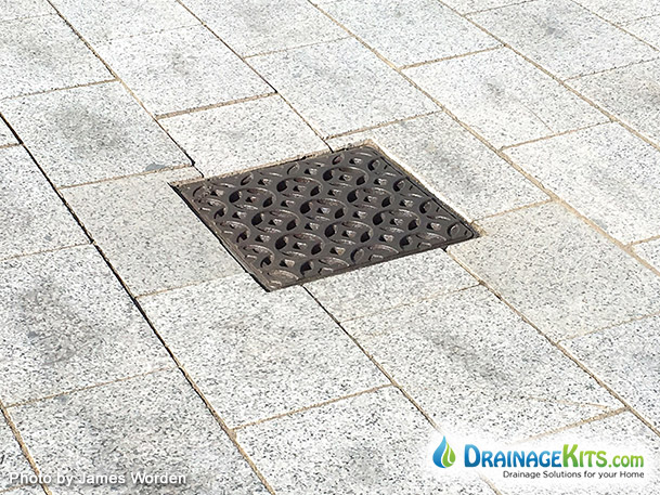Decorative cast iron drainage grates for NDS catch basins