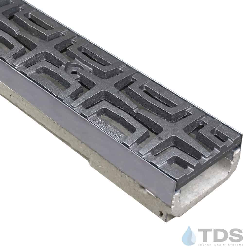 M100KX polymer concrete linear channel with stainless steel edge and Iron Age Carbochon Raw grate