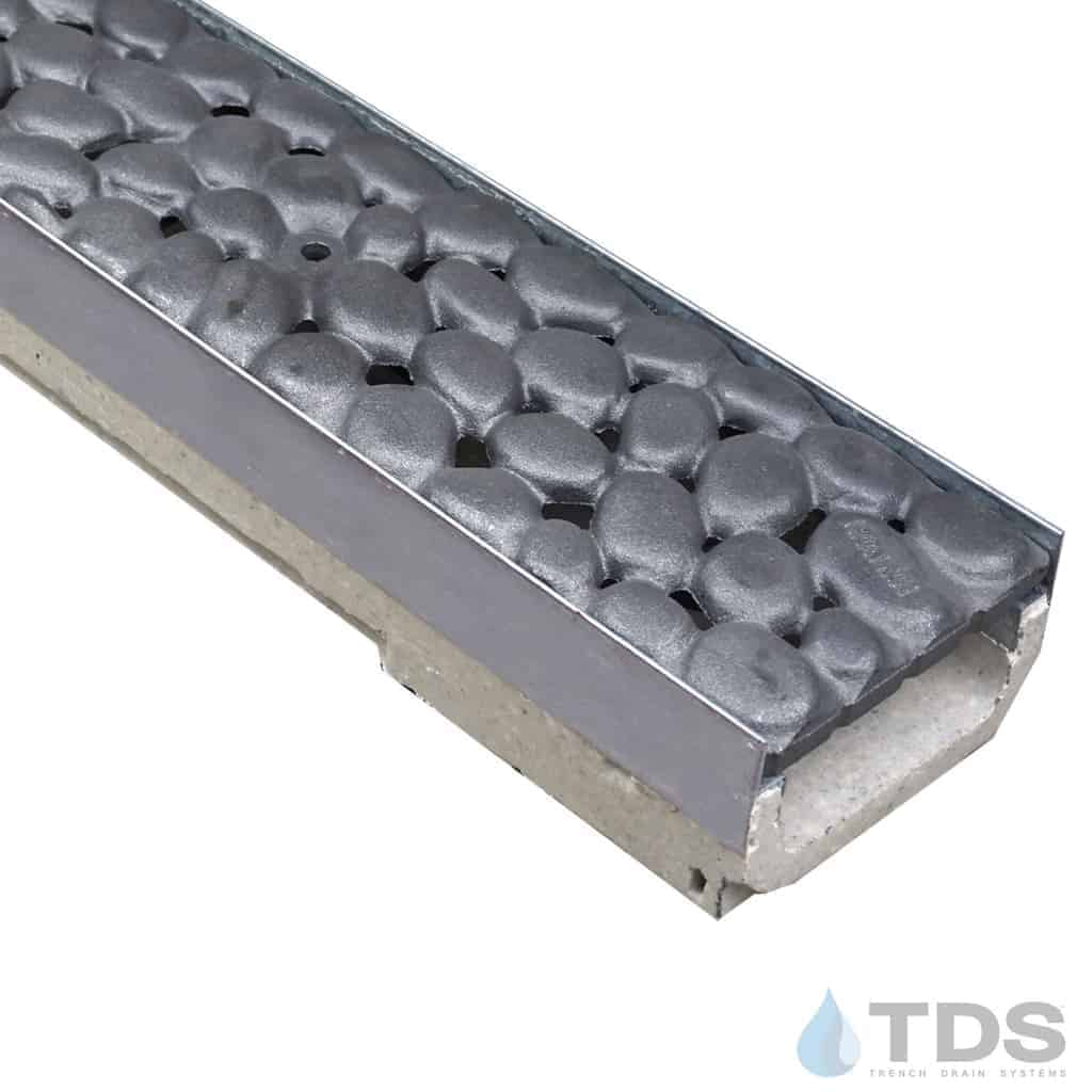 ULMA shallow drain channel with stainless steel edge and Iron Age River Rock cast iron grate